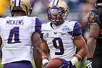 Washington Huskies fullback Myles Gaskin (9) in action during the Zaxby's Heart of Dallas Bowl game between the Washington Huskies and the Southern Miss Golden Eagles at the Cotton Bowl Stadium in Dallas, Texas.