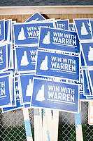 Campaign signs for Democratic presidential candidate and Massachusetts senator Elizabeth Warren rest against a fence before the Labor Day Parade in Milford, New Hampshire, on Mon., September 2, 2019. Candidates Bernie Sanders and Vermin Supreme were the only candidates who marched in the parade this year.