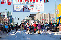 Mark Selland and team leave the ceremonial start line with an Iditarider and handler at 4th Avenue and D street in downtown Anchorage, Alaska on Saturday March 4th during the 2017 Iditarod race. Photo © 2017 by Brendan Smith/SchultzPhoto.com.