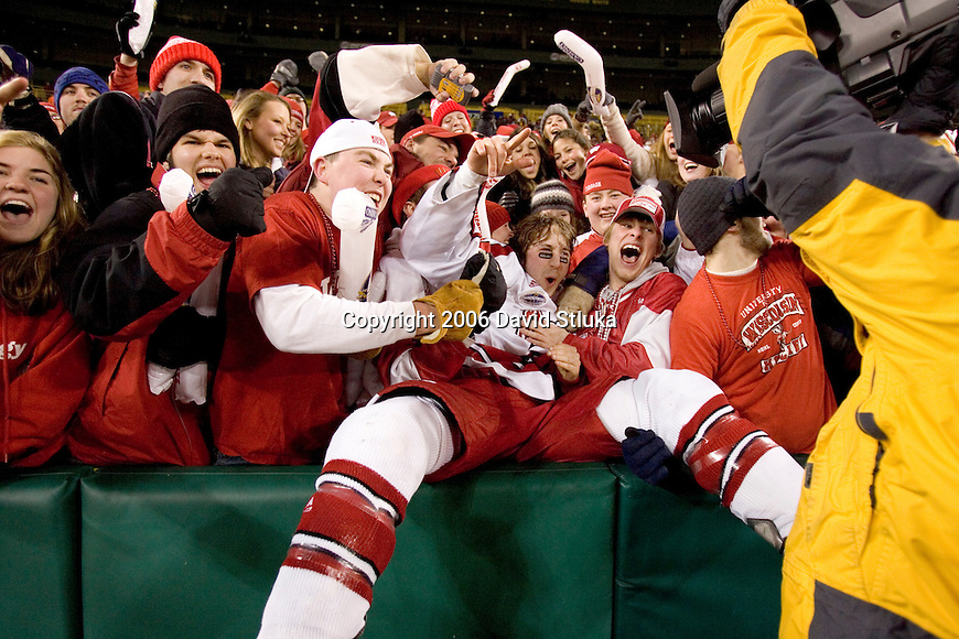 GREEN BAY, WI - FEBRUARY 11: Jeff Likens of the Wisconsin Badgers does the Lambeau Leap after their victory over the Ohio State Buckeyes at Lambeau Field on February  11, 2006 in Green Bay, Wisconsin. The Badgers defeated the Buckeyes 4-2. (Photo by David Stluka)