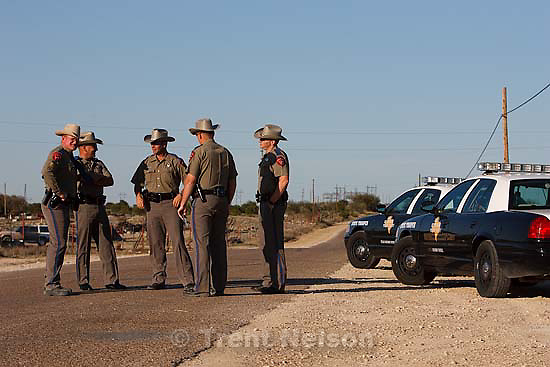 "Eldorado - Texas State Troopers at a roadblock on road CR-300, which leads to the FLDS YFZ ""Yearning for Zion"" compound outside of Eldorado, Texas, Saturday, April 5, 2008, just before the temple was breached."