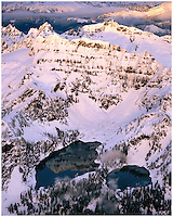Aerial of Columbia Peak reflected in Twin Lakes in winter at sunset, North Cascades Mountain Range, Washington State