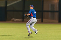 AZL Rangers right fielder Beder Gonzalez (8) prepares to make a throw to the infield during an Arizona League game against the AZL Giants Black at Scottsdale Stadium on August 4, 2018 in Scottsdale, Arizona. The AZL Giants Black defeated the AZL Rangers by a score of 6-3 in the second game of a doubleheader. (Zachary Lucy/Four Seam Images)