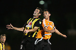 28 March 2007: Charleston's Ian Fuller (left) and Houston's Brad Davis (right) fight for a position and watch the incoming ball. The Houston Dynamo tied the Charleston Battery 1-1 at Blackbaud Stadium in Charleston, South Carolina in a Carolina Challenge Cup preseason match.
