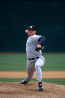OAKLAND, CA:  Roger Clemens of the New York Yankees in action against the Oakland Athletics during a game at the Oakland Coliseum in Oakland, California in 1999. (Photo by Brad Mangin)