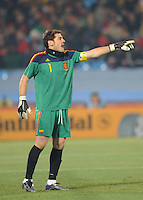 Goalkeeper Iker Casillas gives instructions to his defense. Spain won Group H following a 2-1 defeat of Chile in Pretoria's Loftus Versfeld Stadium, Friday, June 25th, at the 2010 FIFA World Cup in South Africa..