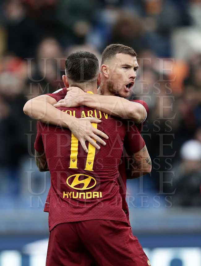 Football, Serie A: AS Roma - Torino, Olympic stadium, Rome, January 19, 2019. <br /> Roma's Aleksandar Kolarov (l) celebrates after scoring with his teammate Edin Dzeko (r) during the Italian Serie A football match between AS Roma and Torino at Olympic stadium in Rome, on January 19, 2019.<br /> UPDATE IMAGES PRESS/Isabella Bonotto