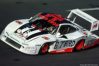 DAYTONA BEACH, FL - FEBRUARY 6: The Porsche 935L driven by A.J. Foyt, Bob Wollek, Claude Ballot-Léna and Preston Henn is driven through the Turn 4 banking enroute to victory in the IMSA Camel GT 24 Hours of Daytona on February 6, 1983, at the Daytona International Speedway in Daytona Beach, Florida.