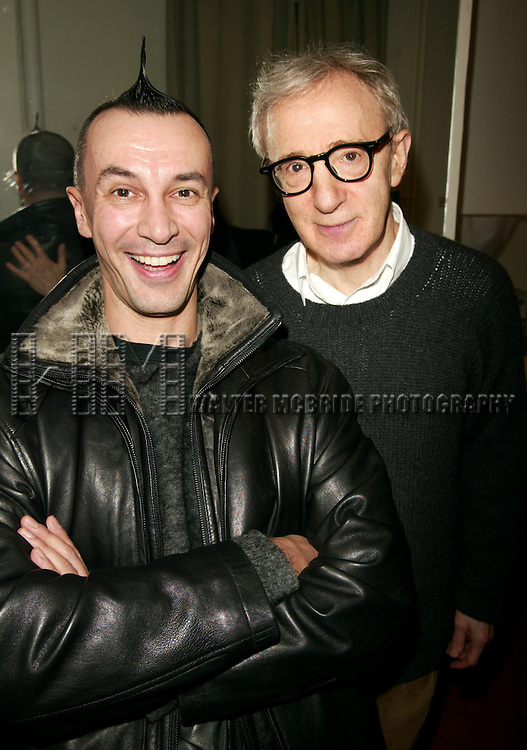 *** EXCLUSIVE Coverage ***.Woody Allen greeted by Quick Change Artist Arturo Brachetti backstage after performing with his New Orleans Jazz Band at Theatre Mogador in Paris, France during their Winter Tour - December 2004..December 20, 2004.© Walter McBride /
