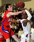 Tolland 3, Dan Vareed, tries to get off a shot as Berlin 15, Colin King, gets his hand in on his his arm, in the first half,  Friday, Feb. 17, 2012, at Tolland High School. (Jim Michaud/Journal Inquirer)