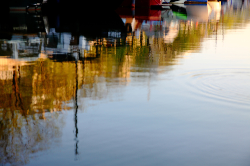 Paris Right Bank: A reflected image of boats at the sunrise in the water of the basin of the port de l'Arsenal.