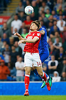 Matty Cash of Nottingham Forest contends with Joe Bennett of Cardiff City during the Sky Bet Championship match between Cardiff City and Nottingham Forest at the Cardiff City Stadium, Wales, UK. Saturday 21 April 2018