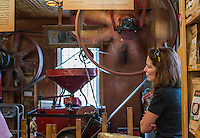 NWA Democrat-Gazette/ANTHONY REYES • @NWATONYR<br /> Marcia Pixler, of Cushing, Okla., looks at the machines Monday, Sept. 7, 2015 at the War Eagle Mill in Rogers. The Mill was celebrating Labor Day with jewelry demonstrations with artist Janet Alexander of Eureka Springs and live country music from Ronny Gibbons of Rogers.