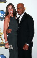 Talk show host Montel Williams poses with his wife backstage at the 35th Annual Daytime Emmy Awards held at the Kodak Theatre in Los Angeles on June 20, 2008.