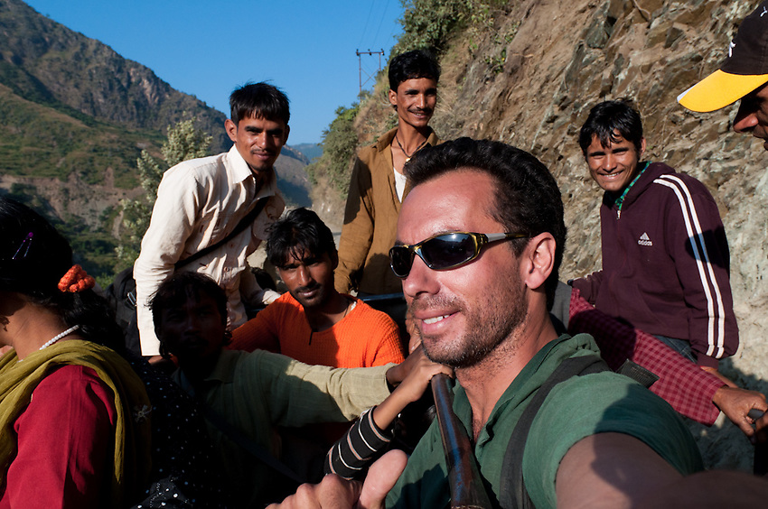 The author rides in the back of a truck in the Yamuna River valley in Garhwal