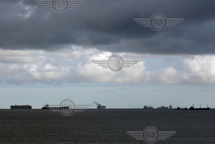 Ships wait off the coast of Panama City for their allotted times to cross the Panama Canal.Photo: Dermot Tatlow/Panos Pictures/Felix Features