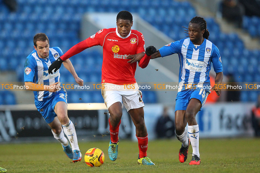 Chucks Aneke of Crewe evades Marcus Bean of Colchester - Colchester United vs Crewe Alexandra - Sky Bet League One Football at the Weston Homes Community Stadium, Colchester, Essex - 29/12/13 - MANDATORY CREDIT: Gavin Ellis/TGSPHOTO - Self billing applies where appropriate - 0845 094 6026 - contact@tgsphoto.co.uk - NO UNPAID USE