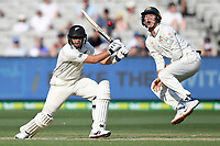 27th December 2019; Melbourne Cricket Ground, Melbourne, Victoria, Australia; International Test Cricket, Australia versus New Zealand, Test 2, Day 2; Marnus Labuschagne of Australia jumps as Ross Taylor of New Zealand hits the ball - Editorial Use