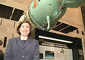 Lori Garver, who aspires to be the second space tourist, poses in front of a Russian Soyuz Spacecraft at the National Air and Space Museum in Washington, DC on April 19, 2002.  This Soyuz is much like the one that will ferry her to the International Space Station if she is selected to make the trip.<br /> Credit: Bob Knudsen / CNP