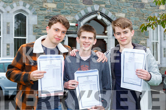 Fion Oliver with twins Harry and James Knoblauch celebrate receiving their Leaving Cert results in St Brendans College Killarney on Tuesday