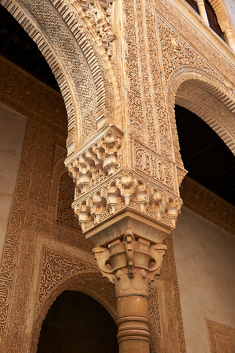 Moorish pillars and capitals in the inner courtyard  of the Palacios Nazaries,  Alhambra. Granada, Andalusia, Spain.
