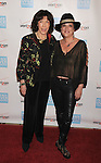 BEVERLY HILLS, CA - OCTOBER 28: Lily Tomlin and Eve Ensler arrive at Peace Over Violence 40th Annual Humanitarian Awards dinner at Beverly Hills Hotel on October 28, 2011 in Beverly Hills, California.