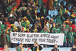"19 JUN 2010: Fans hold a sign reading ""Mr Sepp Blatter, Africa says: Thank you for your trust"". The Denmark National Team defeated the Cameroon National Team 2-1 at Loftus Versfeld Stadium in Tshwane/Pretoria, South Africa in a 2010 FIFA World Cup Group E match."