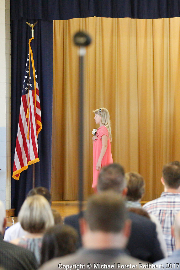 The Oneonta Greater Plains elementary school fifth grade awards ceremony, on June 21, 2017.<br /> &copy; Michael Forster Rothbart Photography<br /> www.mfrphoto.org &bull; 607-267-4893<br /> 34 Spruce St, Oneonta, NY 13820<br /> 86 Three Mile Pond Rd, Vassalboro, ME 04989<br /> info@mfrphoto.org<br /> Photo by: Michael Forster Rothbart<br /> Date:  6/21/2017<br /> File#:  Canon &mdash; Canon EOS 5D Mark III digital camera frame C19078