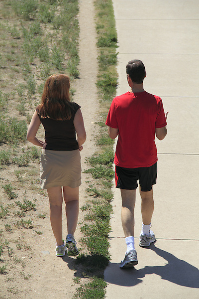 Woman and man walking on trail in Denver, Colorado. .  John offers private photo tours in Denver, Boulder and throughout Colorado. Year-round Colorado photo tours.