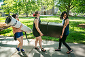 Jen Ricano, left, and her roommate Mehreen Shafqat, right, both sophomores, move their belongings out of Craven with help from friend and dormmate Chelsea Southworth, junior, during Finals Week.