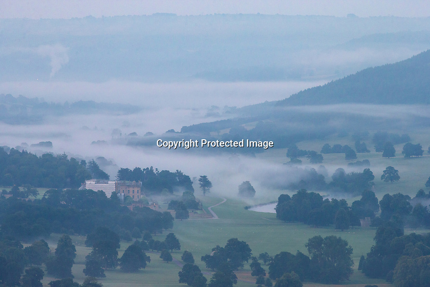 15/08/16<br /> <br /> Chatsworth House and River Derwent.<br /> <br /> After a chilly night in the Peak District, low cloud blankets the stunning Derbyshire countryside as the sun rises over Curbar Edge this morning ahead of a forecast week of late summer hot weather.<br /> <br /> This type of weather phenomena is known as an inversion and can occur when, for example, a warmer, less-dense air mass moves over a cooler, denser air mass. This type of inversion occurs in the vicinity of warm fronts.<br /> <br /> All Rights Reserved, F Stop Press Ltd. +44 (0)1773 550665