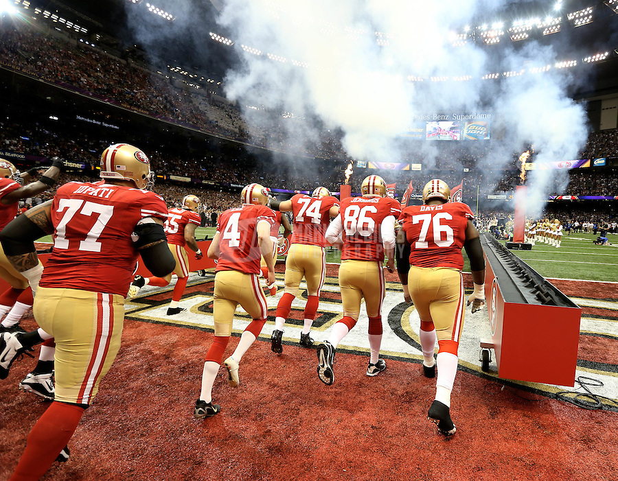 Feb 3, 2013; New Orleans, LA, USA; Members of the San Francisco 49ers take the field before Super Bowl XLVII against the Baltimore Ravens at the Mercedes-Benz Superdome. Mandatory Credit: Mark J. Rebilas-