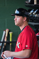 Kannapolis Intimidators manager Cole Armstrong (33) watches the action from the dugout during the game against the Asheville Tourists at Kannapolis Intimidators Stadium on May 26, 2016 in Kannapolis, North Carolina.  The Tourists defeated the Intimidators 9-6 in 11 innings.  (Brian Westerholt/Four Seam Images)