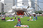 Chicagoans and tourists attend a concert by Luna Negra in the Frank Gehry designed Pritzker Pavilion in Millennium Park in Chicago, Illinois on July 23, 2009.