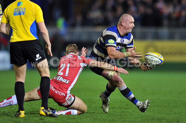Carl Fearns passes the ball. Aviva Premiership match, between Bath Rugby and Gloucester Rugby on October 25, 2013 at the Recreation Ground in Bath, England. Photo by: Patrick Khachfe / Onside Images
