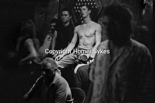 Gay men in a dungeon club. Sydney Australia.