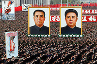 "North Koreans march and chant near the portraits of late North Korean leader Kim Il Sung at left and Kim Jong Il at right in central Pyongyang, North Korea, for a rally denouncing South Korean President Lee Myung-bak on Friday, April 20, 2012. ""Inside DPRK"""