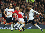 Michael Carrick of Manchester United tackles Christian Eriksen of Tottenham during the English Premier League match at Old Trafford Stadium, Manchester. Picture date: December 11th, 2016. Pic Simon Bellis/Sportimage