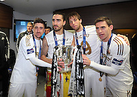 Pictured L-R:Spaniard Swansea players Pablo Hernandez, Chico Flores, Michu and Angel Rangel celebrating with the cup in the changing rooms after the game.  Sunday 24 February 2013<br />
