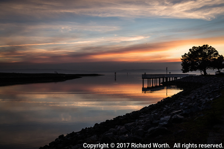 Smoke from wildfires in southern California has traveled the 300 miles up the coast to the San Francisco Bay area.  Sunset at the San Leandro Marina fishing pier.