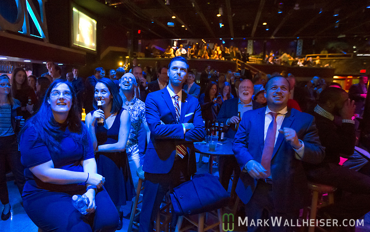 Audience members watch the 62nd Annual Press Skits 2017, The Crony Awards, sponsored by the Florida Capitol Press Corps, held at The Moon in Tallahassee, Florida March 14, 2017.  The funds raised go to the Barbara Frye Scholarship Fund supporting Florida journalism students attending Florida schools.