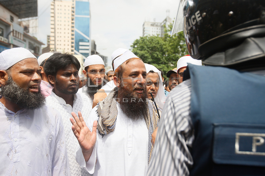 """Today thousand of activists from several Islamic organizations march in a procession in front of the Baitul Mukarram National Mosque to protest against the ongoing Israeli operation """"protective edge"""" and the heavy attacks to the  Gaza Strip which already caused hundreds of casualties , mostly between  civilians and children. Dhaka, Bangladesh"""