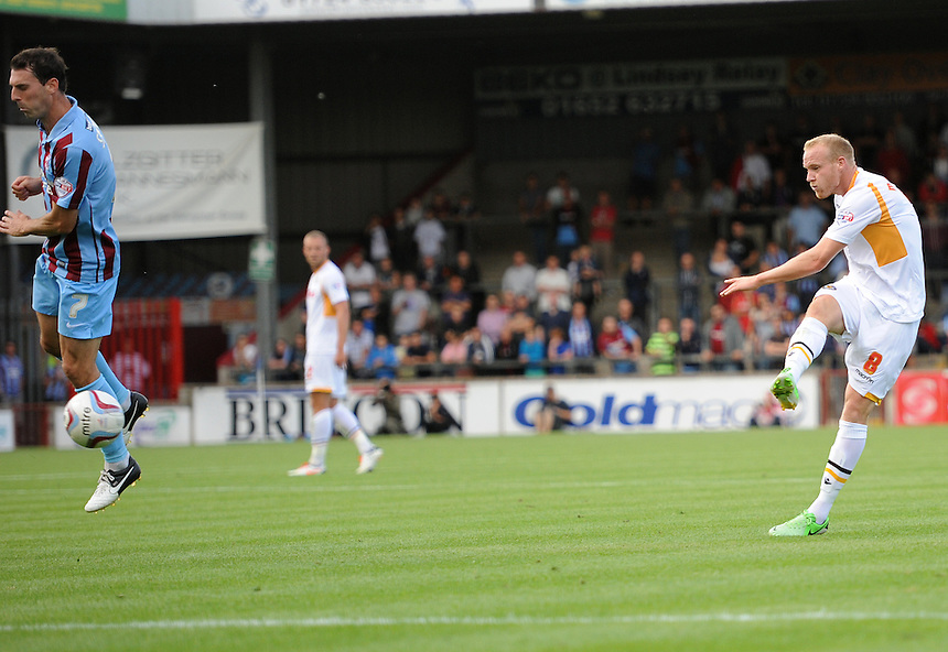 Newport County's Lee Minshull has a shot on goal<br /> <br /> Photo by Ashley Crowden/CameraSport<br /> <br /> Football - The Football League Sky Bet League 2 - Scunthorpe United v Newport County AFC - Saturday 31st August 2013 - Glanford Park - Scunthorpe<br /> <br /> &copy; CameraSport - 43 Linden Ave. Countesthorpe. Leicester. England. LE8 5PG - Tel: +44 (0) 116 277 4147 - admin@camerasport.com - www.camerasport.com