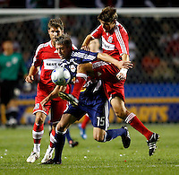 Chicago Fire defender Brandon Prideaux (6) kicks the ball away from New York forward John Wolyniec (15) as Chicago Fire midfielder Logan Pause (7) looks on.  The Chicago Fire defeated the New York Red Bulls 1-0 at Toyota Park in Bridgeview, IL on September 6, 2008.