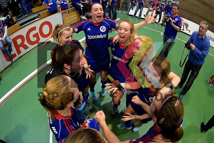 GER - Luebeck, Germany, February 07: Players of Mannheimer HC celebrate after winning the shootout during the 1. Bundesliga Damen indoor hockey final match at the Final 4 between Mannheimer HC (blue) and Duesseldorfer HC (white) on February 7, 2016 at Hansehalle Luebeck in Luebeck, Germany. Final score 6-4 after shootout. <br /> <br /> Foto &copy; PIX-Sportfotos *** Foto ist honorarpflichtig! *** Auf Anfrage in hoeherer Qualitaet/Aufloesung. Belegexemplar erbeten. Veroeffentlichung ausschliesslich fuer journalistisch-publizistische Zwecke. For editorial use only.