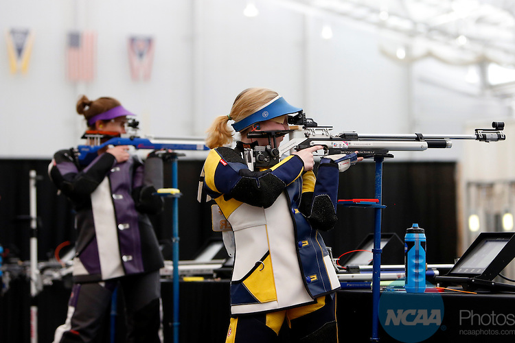 12 MAR 2016:  Ginny Thrasher, right, of West Virginia University, shoots in the NCAA Division I Men's and Women's Rifle Championship held at the Stile Athletics Field House in Akron, OH.  Thrasher won the competition with a final score of 208.8.  Jay LaPrete/NCAA Photos