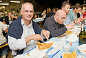 "SAGRA DEL ""PESCE E PATATE"" 2011, BARGA, ITALY<br /> <br /> MARCO BONINI, MAYOR OF BARGA, ENJOYS HIS FISH AND CHIPS."