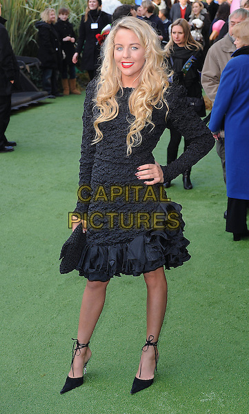 "LYDIA BRIGHT .attending the UK Premiere of ""Gnomeo and Juliet"", Odeon cinema, Leicester Square, London, England, UK, .30th January 2011..& arrivals full length ruched ruffle dress textured ruffles long sleeve hand on hip clutch bag pointy pointed shoes ankle strap .CAP/BEL.©Tom Belcher/Capital Pictures."