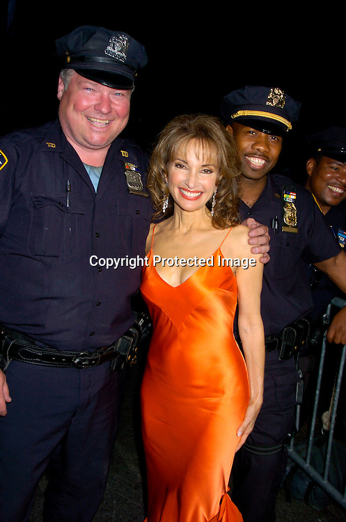 Susan Lucci  and cops ..arriving at the Daytime Emmy Awards on May 21, 2004 at the Sheraton and at Radio City Music Hall...Photo by Robin Platzer, Twin Images