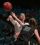 Idaho's Geraldine McCorkell passes the ball over Portland State's Courtney West in a women's Big Sky Tournament semi-final game held at the Reno Events Center on Friday, March 9, 2018 in Reno, Nevada.